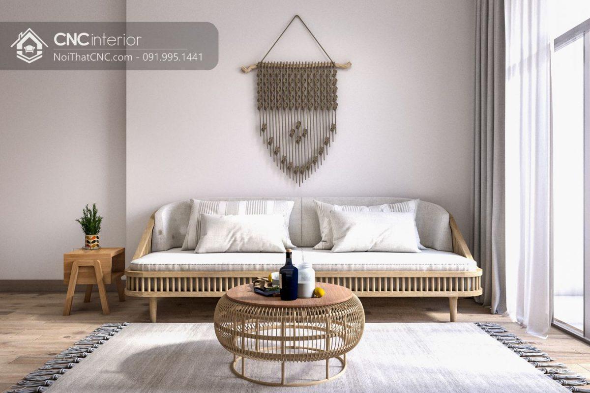 Sofa khung gỗ sồi mang lại cảm giác chắc chắn, kết hợp đôn trang trí có chân, phụ kiện treo tường mang hơi hướng phong cách Boho (du mục)