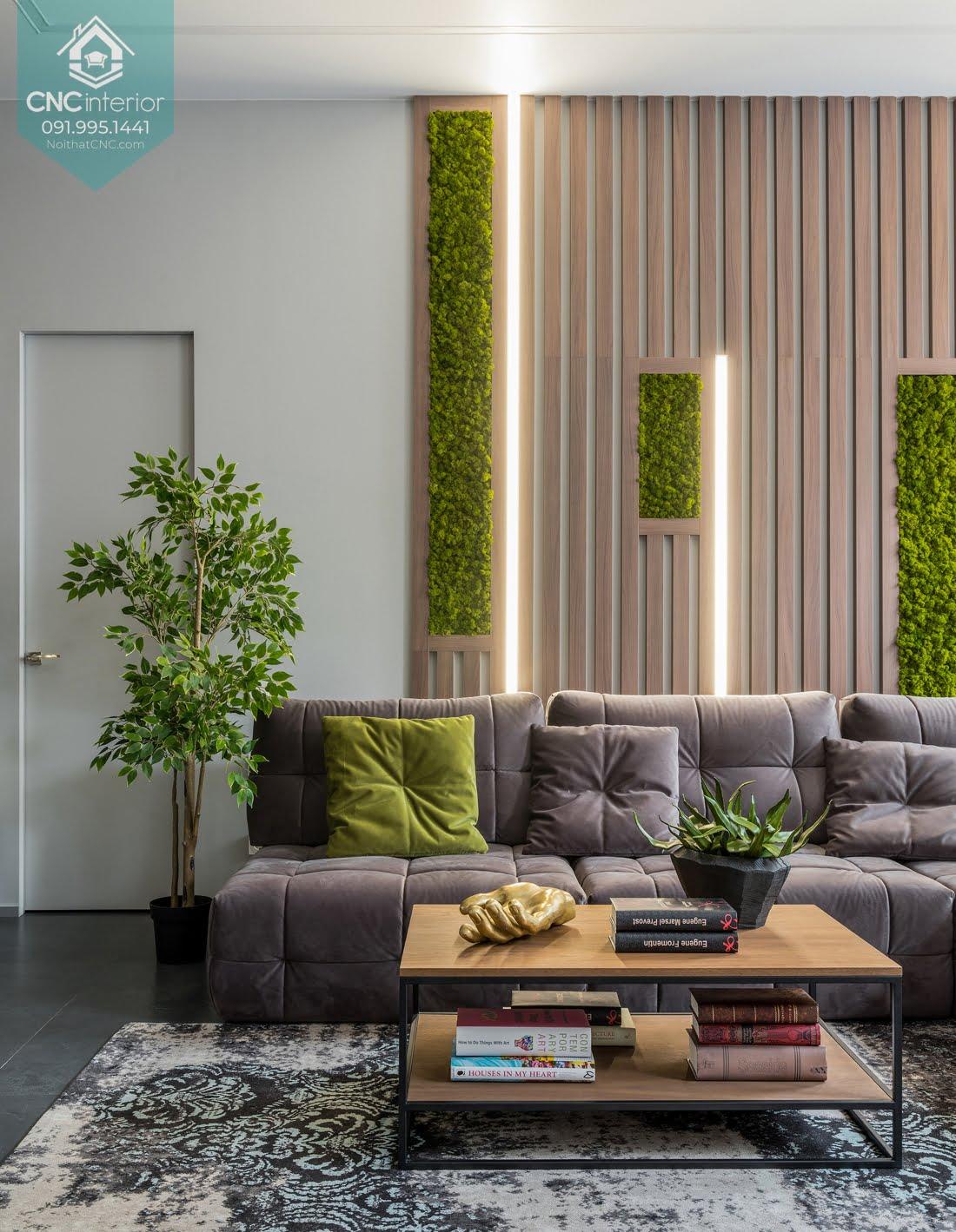 Mẫu gố ốp tường phòng khách bằng gỗ kết hợp với trang trí cây xanh cho không gian thân thiện