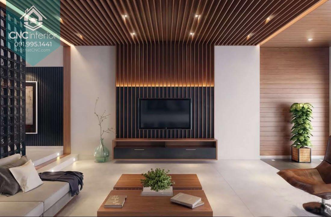 Các nan gỗ ốp tường được kéo dài lên đến trần nhà mang đến phòng khách đẹp và sang trọng