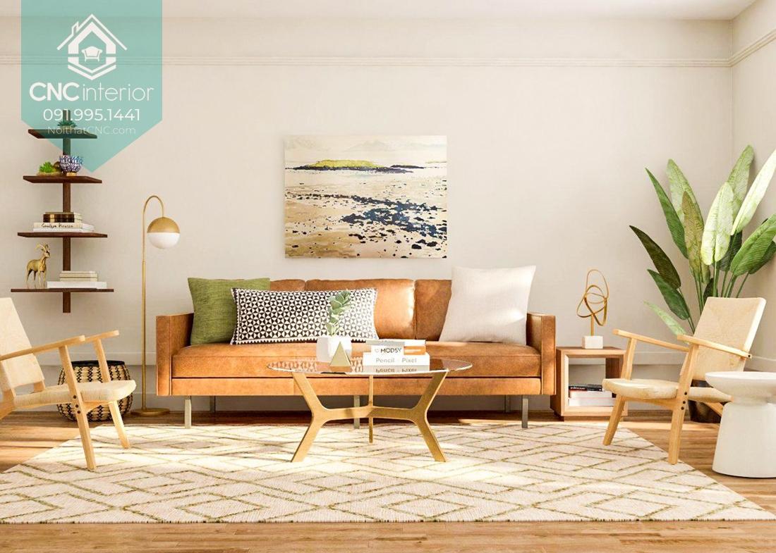 Cây xanh và bức tranh lớn tạo sự trang trí trong phòng khách